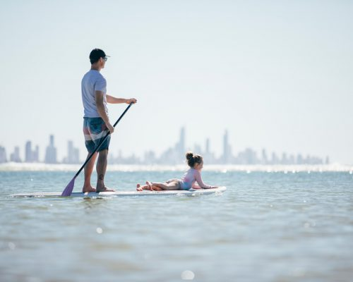 father-and-daughter-stand-up-paddle-boarding